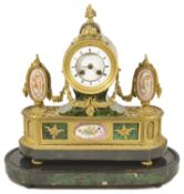 A French porcelain mounted ormolu mantle clock circa 1860 inset with simulated green stained