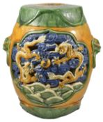 A Oriental pottery polychrome painted garden seat, 20th century of cylindrical form with incised and