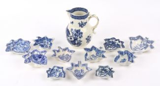 An 18th Century Worcester parrot and fruit pattern jug crescent mark to base together with an