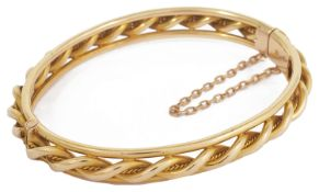 A Victorian 15ct gold rope twist bangle bangle of hinged construction with central rope twist with