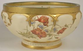 A Royal Worcester blush ivory centre bowl, dated 1896 of circular form with gilt metal rim band