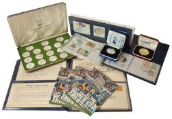 A selection of Sporting and Memorabilia Coins comprising of four 1982 Isle of Man Official World Cup