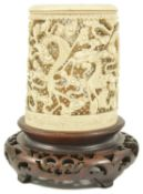 A Chinese 19th century carved ivory brush stand the cylindrical shaped holder carved with several