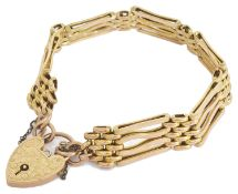 A Edwardian 9ct gold fancy four bar gate bracelet with heart padlock fastening the inner shaped bars