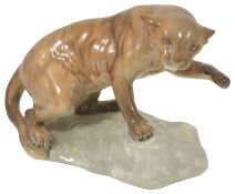 A Beswick puma on rock, 1960's realistically modelled in a tawny gloss standing on a rock with one