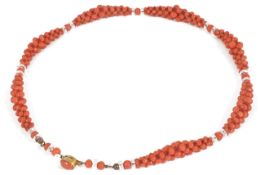 An attractive Edwardian natural coral woven bead necklace the woven bead sections spaced with