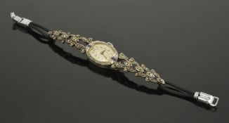 A Continental delicate sapphire and diamond set oval cocktail watch, circa 1910the white metal