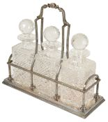 An impressive modern silver sectional decanter holder of Tantalus form, Sheffield 1999 with three
