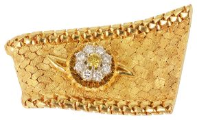 A good quality Continental fancy yellow diamond cluster 'ribbon' lapel pincirca 1970, formed as an