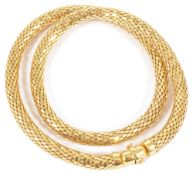 A contemporary 9ct gold mesh choker necklaceformed as a continuous woven mesh hollow tube with