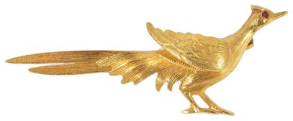 A 9ct gold pheasant broochhaving ruby set eye and naturalistic engraved feather detail, fully marked