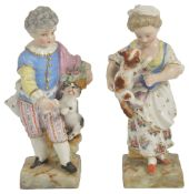 A pair of Meissen porcelain figurines, late 19th century,modelled as a boy with a dog on his heels