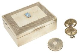 A silver cigarette boxthe rectangular engine turned decorated with hinged lid and wood lined