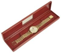 A Roamer 14k gold gentleman's wristwatch with 9ct gold bracelet strapthe circular dial with baton