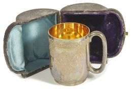 A Victorian silver christening mug, London 1878of typical form with flower head engraved bands,