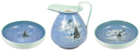 A Royal Doulton porcelain suite with yachting scenes,comprising two large wash bowls, each with