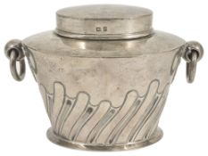 An Edwardian silver tea caddy, Birmingham 1905of oval partial fluted form with ring handles, by
