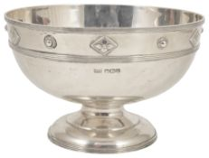 A George VI Arts and Crafts silver pedestal bowl, Sheffield 1937of circular form with applied bead