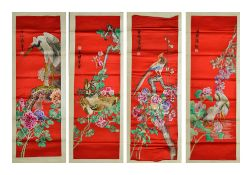 A set of four Chinese red silk wall hangings, 20th centuryeach embroidered with colourful flower
