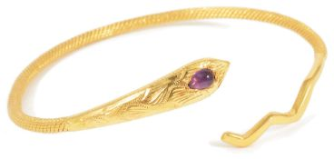 A contemporary 18ct gold woven snake banglethe serpent's head set with a single tear shaped cabochon