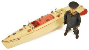 A Meccano Hornby Speedboat Racer IIIwith cream body and red trim, no key, factory label on body,