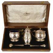 A George V three piece silver cruet suite, Birmingham 1917,comprising pepperette, salt and