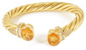 An attractive Continental 18ct gold yellow gem and diamond twist torque banglethe open ended