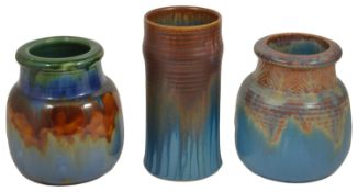 A selection of Bourne Denby pottery jars, mid 20th centurycomprising a cylindrical tall ribbed jar