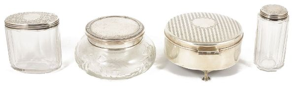 A collection of silver dressing tablewarecomprising a circular hinged lidded silver jewellery box,