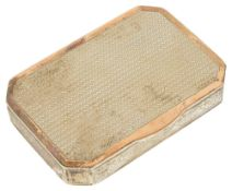 A Continental silver gilt rectangular canted box, the engine turned base and hinged top with swags