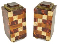 A pair of faux tortoiseshell veneered garniture square section columns