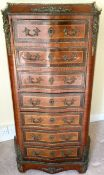 A French gilt bronze-mounted tulip wood and rosewood serpentine secretaire a abattant