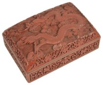 A Chinese rectangular carved cinnabar lacquer dragon box and cover, 20th centurythe lid carved