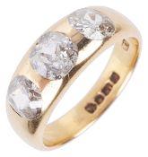 A gentleman's 18ct gold mounted three stone diamond set ring,