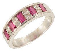 A good quality ruby and diamond set platinum half eternity ring