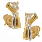 A pair of elegant contemporary triangular cut diamond set earrings