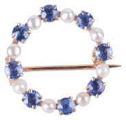 A delicate Continental small pearl and sapphire set circle brooch