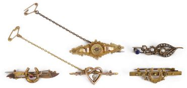 A collection of five Victorian brooches,