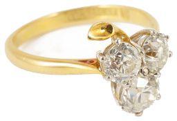 An attractive Edwardian three stone diamond set 'clover leaf 'ring