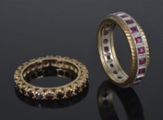 A square ruby set full eternity ring and a garnet set eternity ring