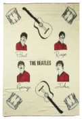 A Witney 'Beatles' blanket, illustrated with images of the four Beatles, with red wool needle work e