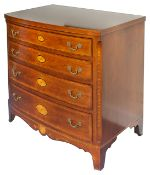 A mahogany and string inlaid bowfront chest of drawers, 20th century