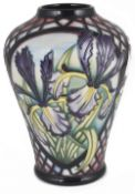 A contemporary Moorcroft pottery 'Siberian Iris' vase by Sian Lepper, design date 2003