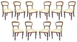 A suite of ten Victorian mahogany balloon back dining chairs