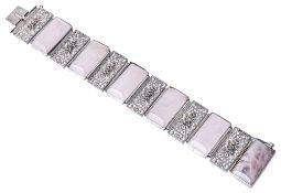 A Continental Art Deco filigree and rose quartz set panel bracelet