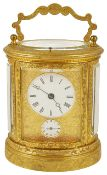 An oval four glass gilt metal repeater carriage clock, late 19th century