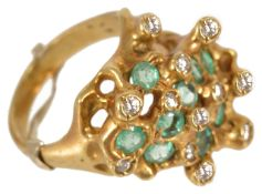 An unusual modernist design emerald and diamond set cocktail ring,