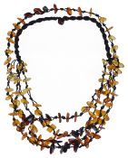 A modern polished amber and silk multi strand necklace