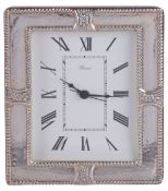 A modern clock with silver frame