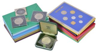 A collection of fourteen Royal Mint coinage sets